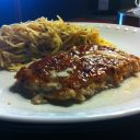 Salmon with a Fig sauce served with angel hair pasta!