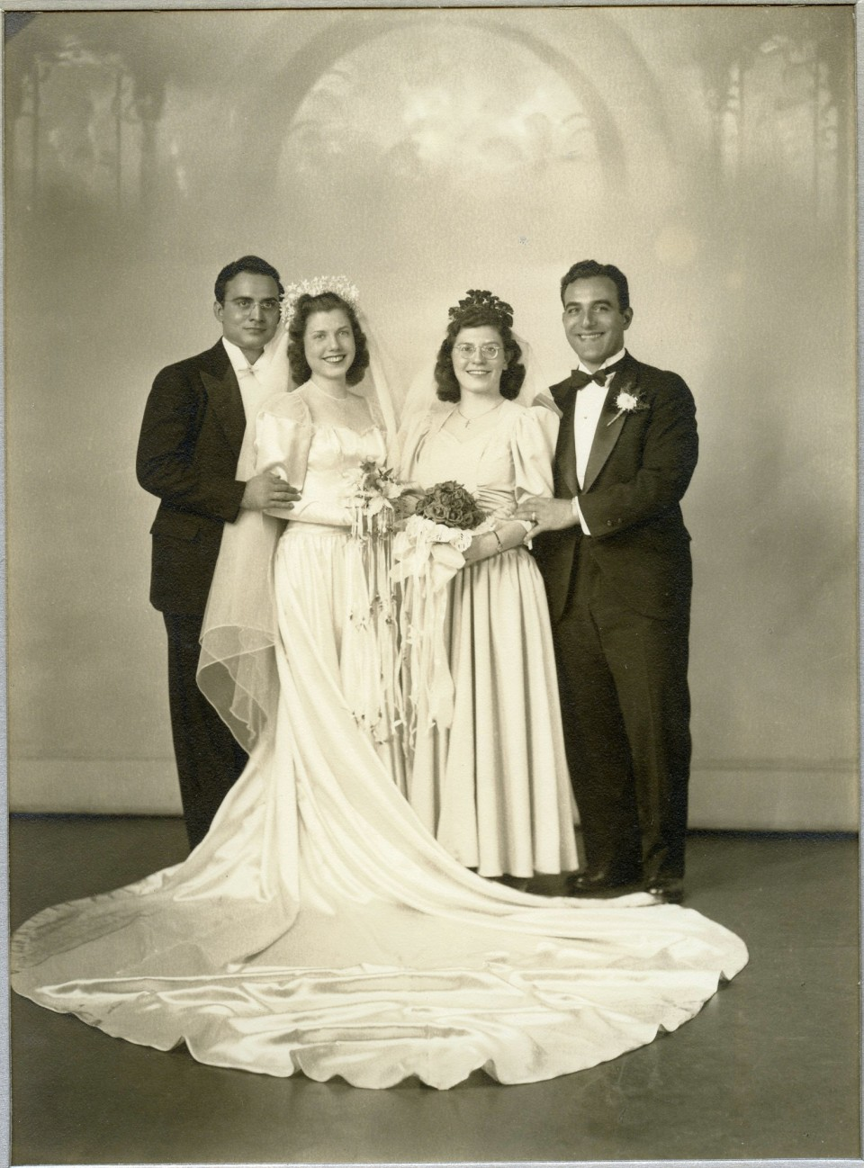 My Paternal Nonna Filomena Cornacchia on her Wedding Day in 1942.  Also in the photo are Antonio Maringola, Virginia Puzzo, and Alfredo Maringola.  The Maringolas were from Corigliano Calabro, Calabria and the Cornacchia's from Monteleone di puglia/Mercogliano, avellino.